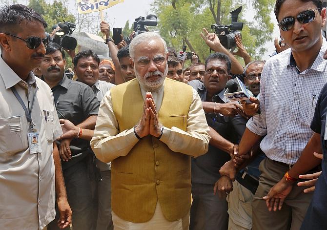Modi gestures as he arrives to seek blessings from his mother Heeraben at her residence in Gandhinaga