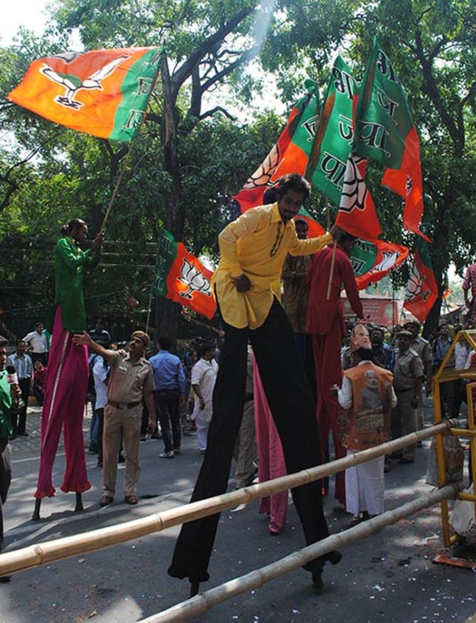 BJP supporters celebrate outside the BJP headquarters.