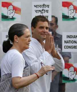 Congress President Sonia Gandhi with her son Rahul Gandhi after the party's debacle on May 16, 2014