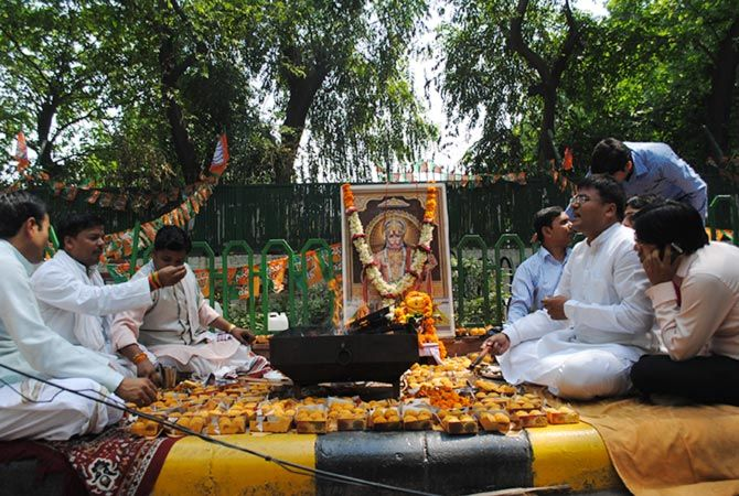 Priests gather on the road to carry out a victory yagna for Modi