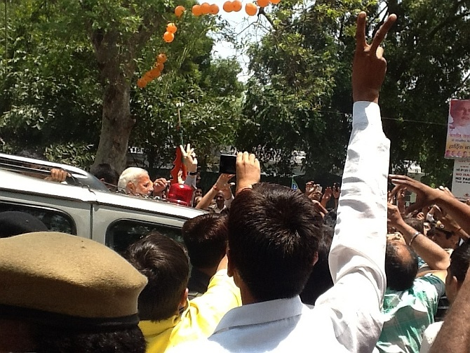 A triumphant Narendra Modi arrives at the BJP's national headquarters, May 17, 2014. Photograph: Vaihayasi Pande Daniel/Rediff.com