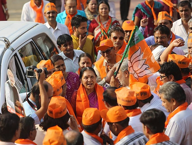 Anandiben Patel (in the pink saree) is thronged by BJP supporters