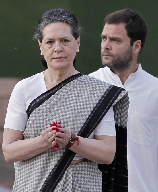 Congress president Sonia Gandhi pays tribute at her husband Rajiv Gandhi's memorial as her son lawmaker Rahul watches on the 21st anniversary of the former prime minister's death in New Delhi.
