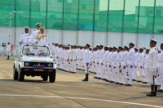 Chief of the Naval Staff Admiral R K Dhowan inspects a guard of honour at the Western Naval Command in Mumbai