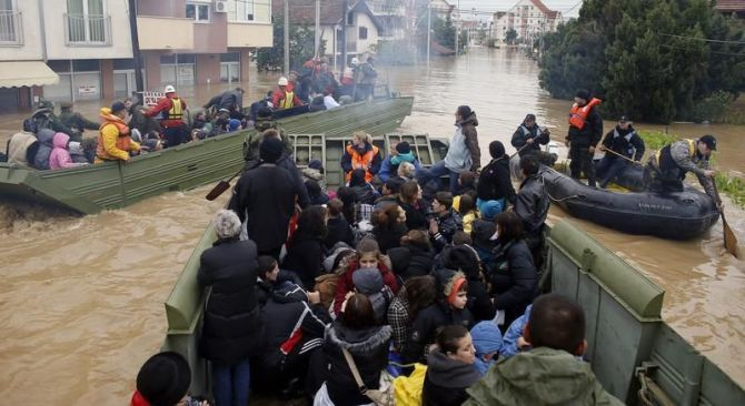 Serbian army soldiers evacuate people in amphibious vehicles in the flooded town of Obrenovac, southwest of Belgrade.