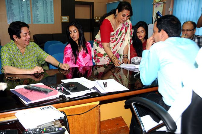 Moon Moon Sen filing her nomination papers in presence of her daughters and her husband.