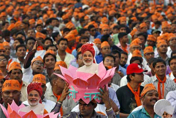 BJP supporters cheer for Narendra Modi during a campaign rally in UP