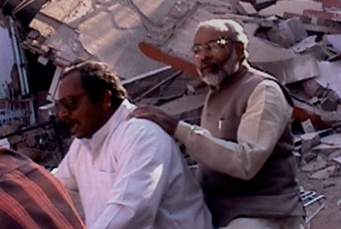 Modi on bike surveying the damage after the Gujarat earthquake.