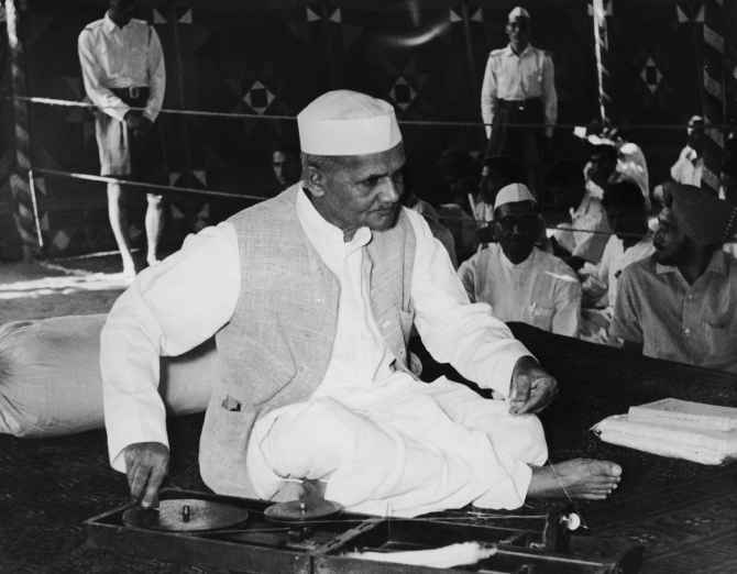 Lal Bahadur Shastri celebrates his own and Mahatma Gandhi's birthday, October 2, by spinning the charkha at the Gandhi samadhi in New Delhi.