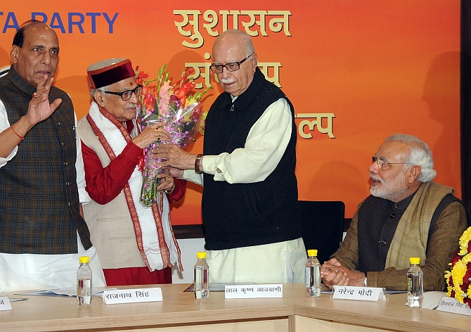 BJP chief Rajnath Singh, veteran leaders M M Joshi and L K Advani with Modi