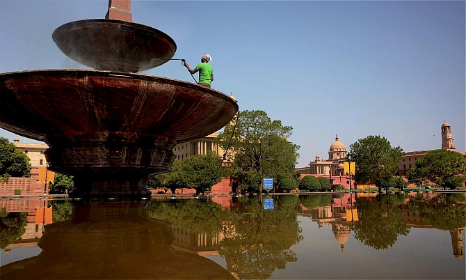 A worker busy with cleaning work near Vijay Chowk as part of preparations for the swearing-in ceremony of the new prime minister in New Delhi