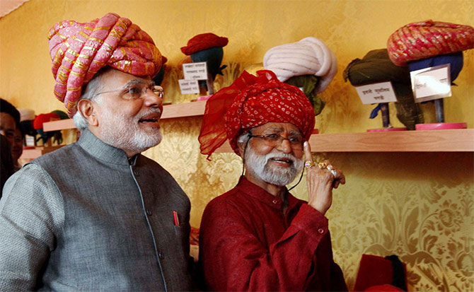 Prime Minister Narendra Modi, left, in a traditional Gujarati turban.