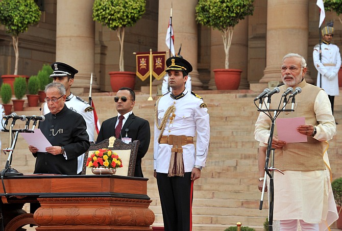 Prime Minister Narendra Modi is administered the oath to office by President Pranab Mukherjee