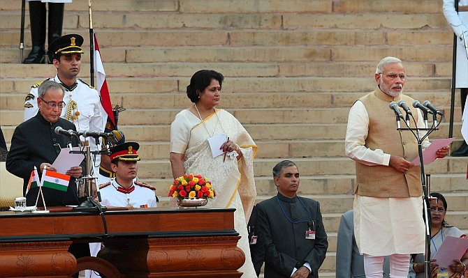 Narendra Modi taking oath as the 15th prime minister of India, at a ceremony at Rashtrapati Bhavan in New Delhi on Monday