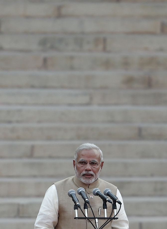 India's Prime Minister Narendra Modi takes his oath at the presidential palace in New Delhi India's Prime Minister Narendra Modi takes his oath at the presidential palace in New Delhi