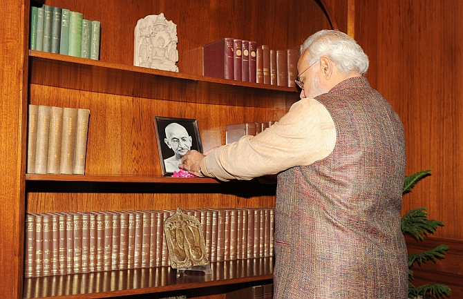 Modi pays floral tributes at the portrait of Mahatma Gandhi in his office