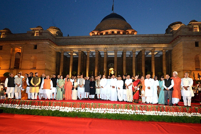 Modi and his council of ministers pose for photographs along with President Pranab Mukherjee and Vice President Hamid Ansari at Rashtrapati Bhavan after the oath-taking ceremony
