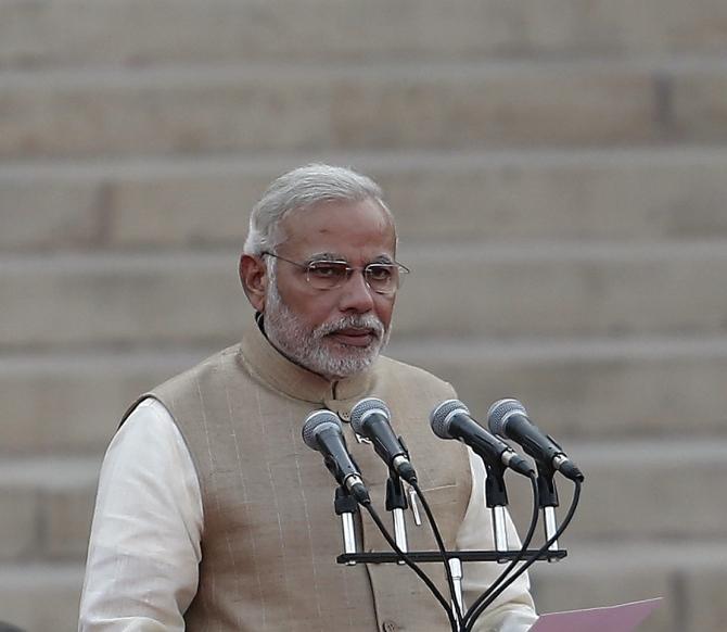 Prime Minister Narendra Modi takes oath in the forecourt of Rashtrapati Bhavan in New Delhi on Monday, May 26, 2014.