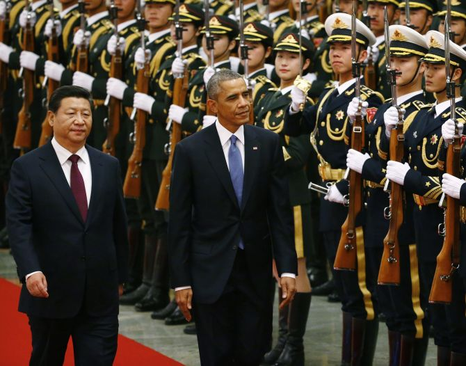 Chinese President Xi Jinping with Barack Obama as the American president inspects an honour guard at the Great Hall of the People in Beijing, November 12, 2014. Photograph: Petar Kujundzic/Reuters