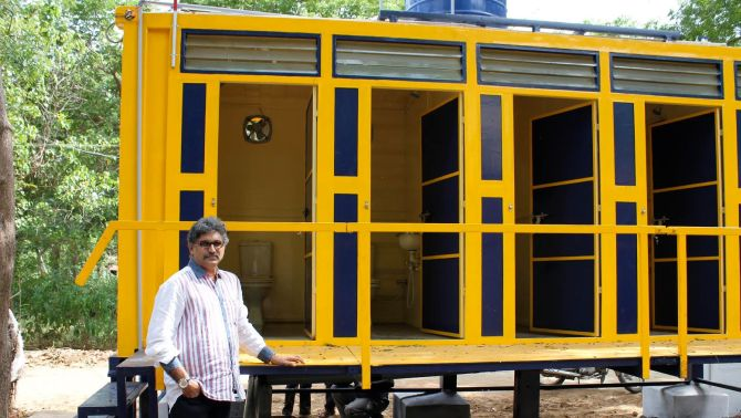How a ship container solved the toilet problem in a tn for Shipping container public bathroom