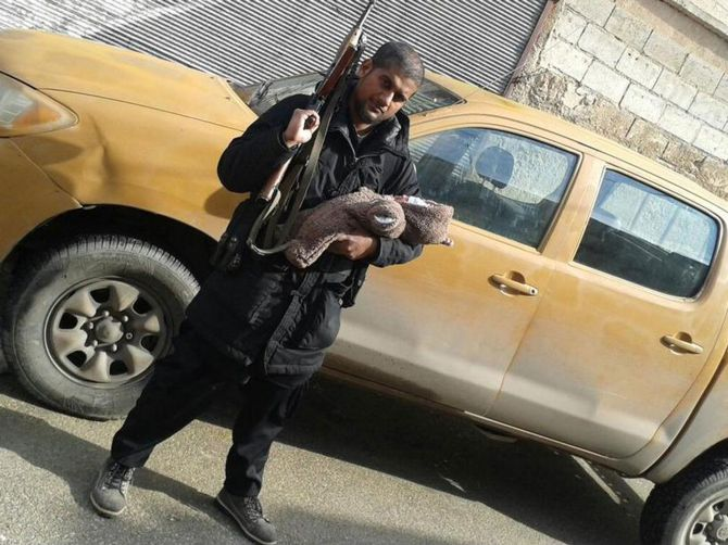 India News - Latest World & Political News - Current News Headlines in India - Indian-origin IS militant poses with his baby and AK-47 on Twitter