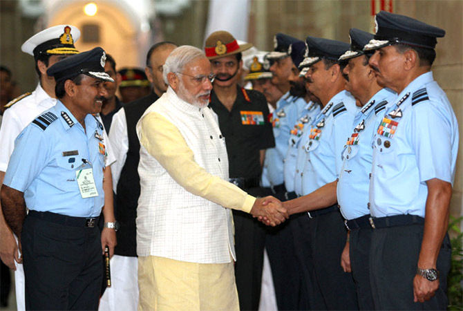 Air Chief Marshal Arunp Raha introduces Prime Minister Modi to air force commanders.
