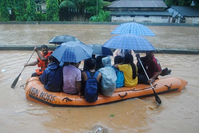 PHOTOS: Floods kill 10