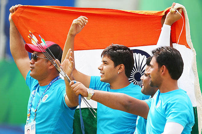 Rajat Chauhan, Sandeep Kumar and Abhishek Verma of India celebrate claiming the Gold medal in the Men's Compound Men's Team Gold Medal Match