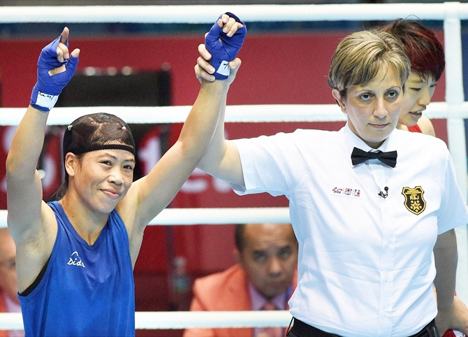 Mary Kom celebrates her victory on Saturday