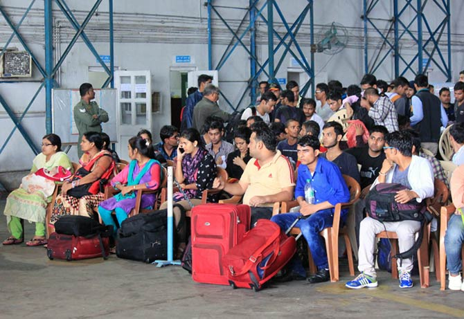 People waiting to be transported at the air base