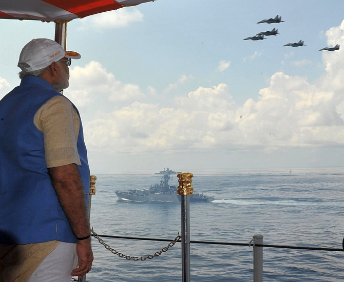 Prime Minister Narendra Modi witnesses an air show aboard the INS Vikramaditya off the Kochi coast, December 15, 2015. Photograph: Press Information Bureau