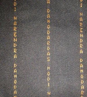 PM's suit with his name woven on it