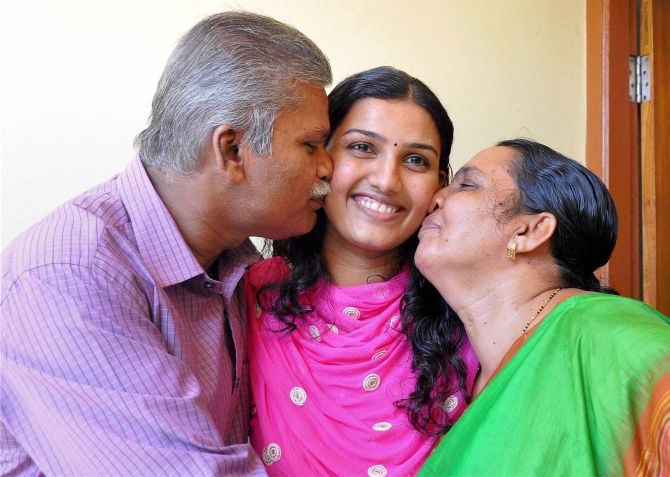 Renu Raj, 2nd rank-holder in UPSC exam, with her parents