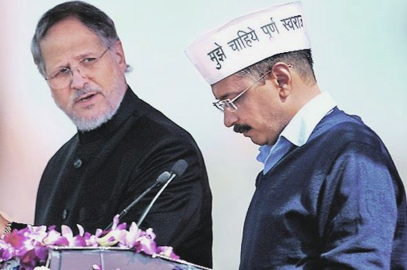 Najeeb Jung, then Delhi's lieutenant governor, with Chief Minister Arvind Kejriwal