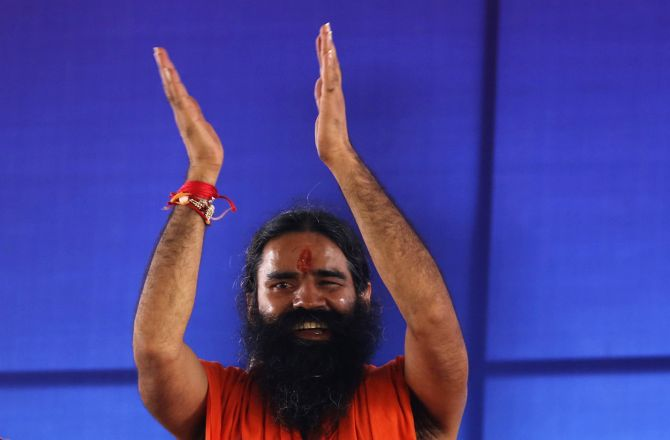 Indian Yoga Guru Swami Ramdev Gestures To His Supporters At The Ramlila Grounds During Agitation Against Corruption And Black Money