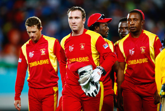 Brendan Taylor of Zimbabwe leads the team off the field at the end of the game against India during the World Cup match at Eden Park in Auckland on Saturday