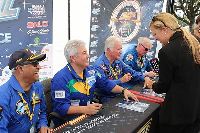 Four international astronauts, from left, India's Rakesh Sharma, Brazil's Marcos Pontes, France's Jean-Loup Chretien, and America's Jon McBride