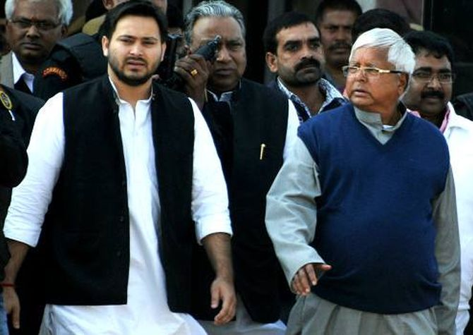 IMAGE: Tejaswi Yadav with his father Lalu Prasad Yadav. Photograph: Tejaswi Yadav/Facebook