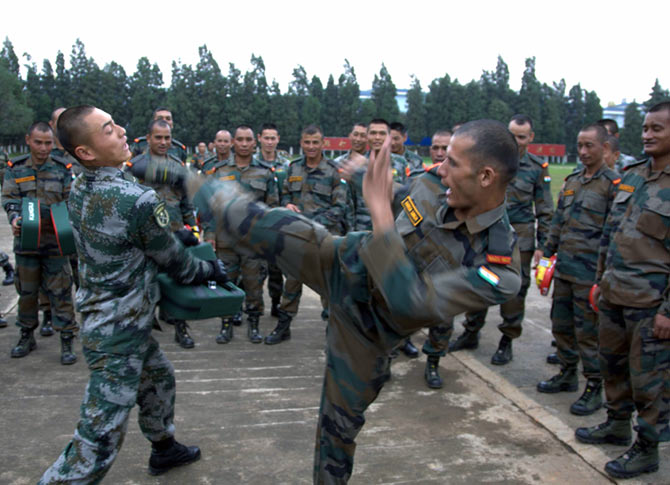 An Indian soldier tries out his martial arts on a Chinese trooper during the India-China military exercises in Kunming, south-west China, October 2015. Photograph: Kind courtesy The Indian Army