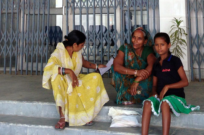 People outside a government hospital in Bihar