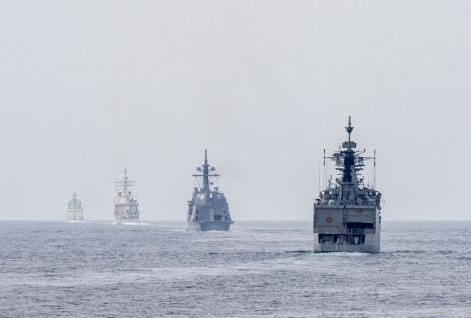 Ships from the Indian navy, Japan Maritime Self Defense Force and US Navy get into formation for a gunnery live-fire exercise as part of Malabar 2015.