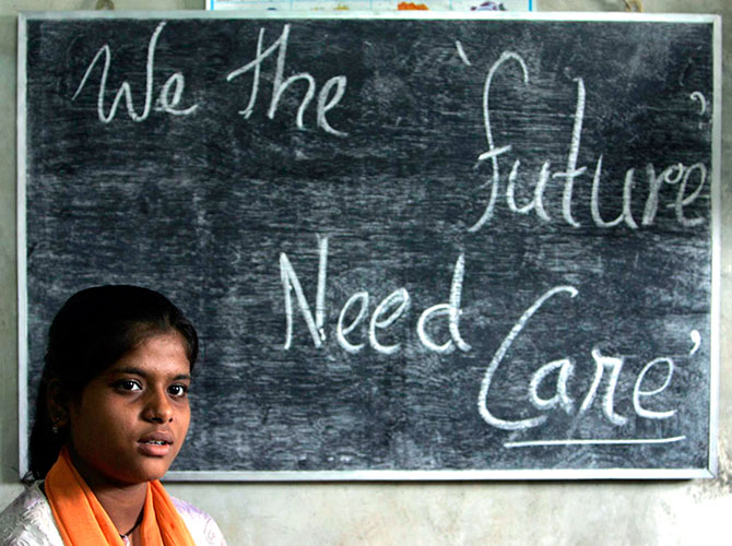 In this September 5, 2007 image, Rekha Sharma, 13, a house servant, attends a class at Sishu Sikha Niketa', a school for child labourers in Siliguri. The school, along with Ananda Vidya Mandir, another school for child labourers, is run by the Liberal Association for Movement of People, LAMP. Photograph/Rupak De Chowdhuri/Reuters