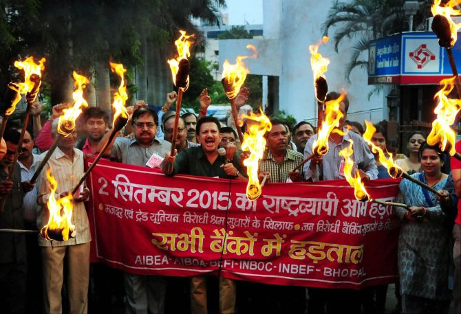 Bank workers stage a torch rally in Bhopal in support of the nation-wide strike September 2, 2015 to protest against the proposed labour reforms by the central and state governments. Photograph: PTI Photo