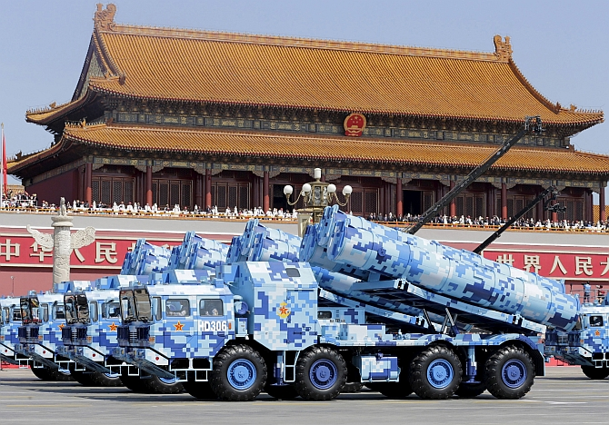 China displayed over 500 pieces of latest weaponry and nearly 200 aircraft of about 20 different models at the September 3 military parade. Military vehicles carrying shore-to-ship missiles drive past Tiananmen Gate. Photograph: Jason Lee/Reuters