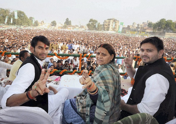 Tej Pratap, left, and Tejaswi Yadav flank their mother Rabri Devi.