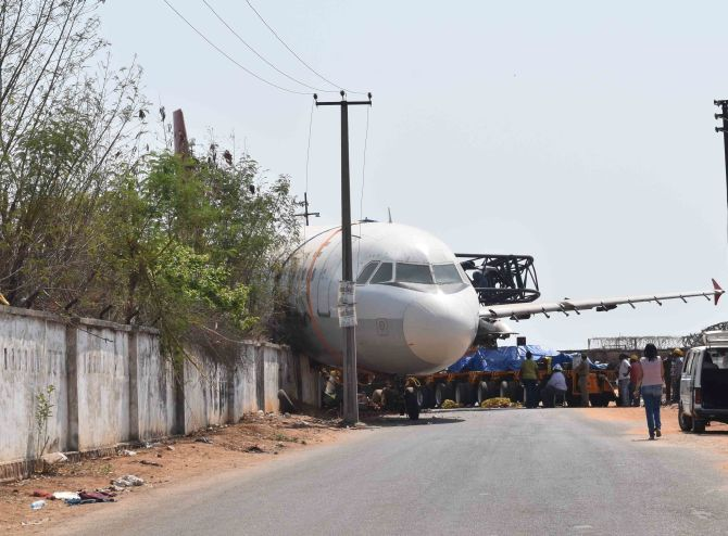 India News - Latest World & Political News - Current News Headlines in India - PHOTOS: Crane carrying aircraft crashes into wall