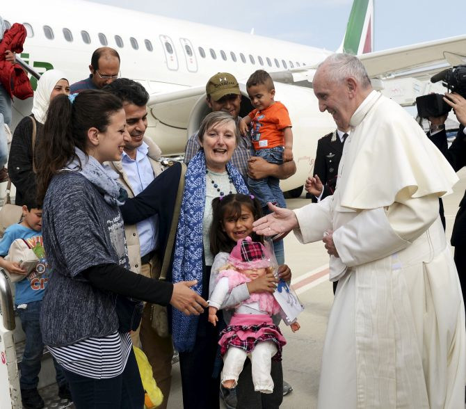India News - Latest World & Political News - Current News Headlines in India - 'You are not alone': Pope brings 3 refugee families from Greece to Rome