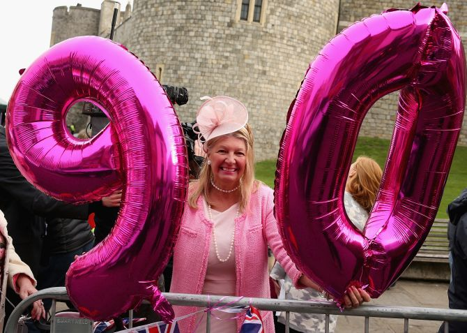 India News - Latest World & Political News - Current News Headlines in India - Portraits, gun salutes as Britain's Queen Elizabeth turns 90