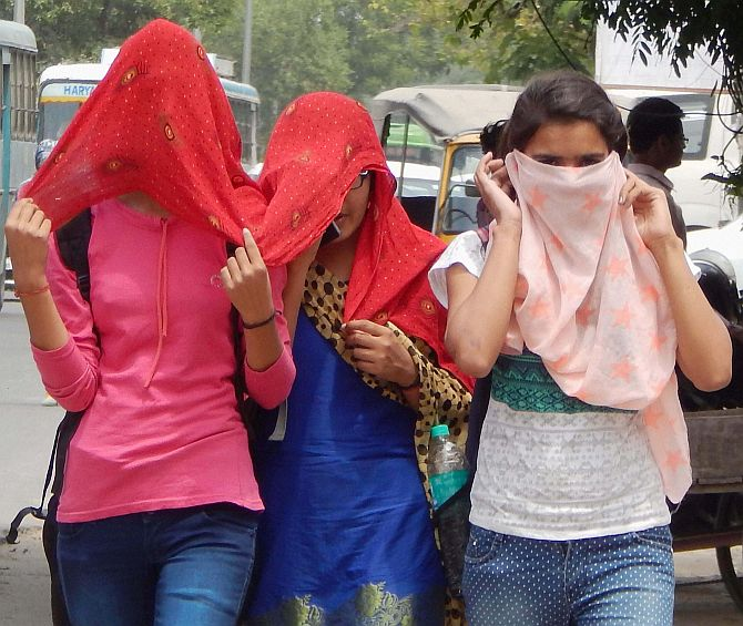 India News - Latest World & Political News - Current News Headlines in India - PHOTOS: Indians finding it too hot to handle