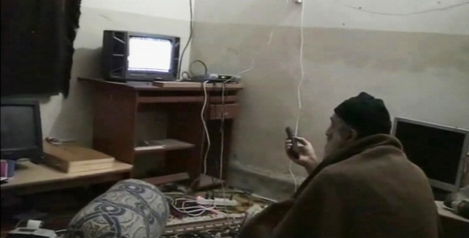 Osama bin Laden is shown watching himself on television in this video frame grab. Photograph: Pentagon/Reuters
